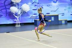 Orenburg, Russia - November 25, 2017 year: girl performs exercises with gymnastic hoop in rhythmic gymnastics Stock Photos