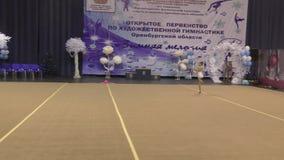 Orenburg, Russia - November 25, 2017 year: girl performs exercises with gymnastic hoop in rhythmic gymnastics. On the Championship Orenburg region on rhythmic stock video footage