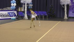 Orenburg, Russia - November 25, 2017 year: girl performs exercises with gymnastic hoop in rhythmic gymnastics. On the Championship Orenburg region on rhythmic stock video