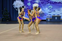 Orenburg, Russia - November 25, 2017 year: girls compete in rhythmic gymnastics perform exercises with sports clubs Royalty Free Stock Photography