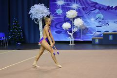Orenburg, Russia - November 25, 2017 year: girls compete in rhythmic gymnastics perform exercises with sports clubs Stock Images