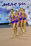 Orenburg, Russia - November 25, 2017 year: girls compete in rhythmic gymnastics perform exercises with sports clubs Royalty Free Stock Image