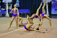 Orenburg, Russia - November 25, 2017 year: girls compete in rhythmic gymnastics perform exercises with sports clubs Stock Photos