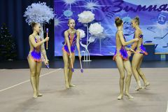 Orenburg, Russia - November 25, 2017 year: girls compete in rhythmic gymnastics perform exercises with sports clubs Stock Photography