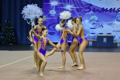 Orenburg, Russia - November 25, 2017 year: girls compete in rhythmic gymnastics perform exercises with sports clubs Stock Image
