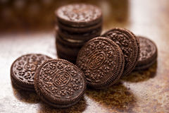 Oreo cookies on dark brown background
