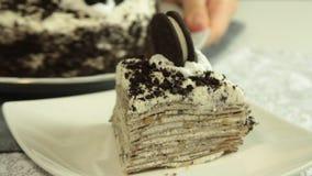 Oreo crape cake recipe. Oreo crape cake with exotic fruits in the home kitchen closeup stock footage
