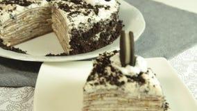 Oreo crape cake recipe. Oreo crape cake with exotic fruits in the home kitchen table closeup stock video
