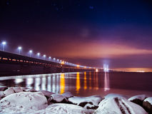 The Oresund bridge by night. The Oresund bridge between Malmö and Copenhagen shot by night in snowy conditions, with stars in the sky Stock Photo