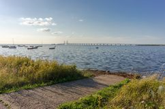 Oresund and Oresund Bridge. Viewed from Bunkeflostrand in Malmo, Sweden on a sunny summer day. The bridge is 7845 meters long and continues into the Drogden Stock Images