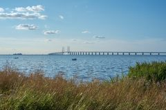 Oresund and Oresund Bridge. Viewed from Bunkeflostrand in Malmo, Sweden on a sunny summer day. The bridge is 7845 meters long and continues into the Drogden Stock Image