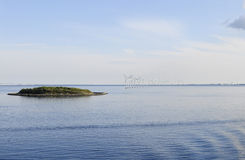 Oresund Isle and Modern Wind Turbines on Water Stock Photo