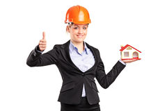 Orewoman holding a model house Royalty Free Stock Photo