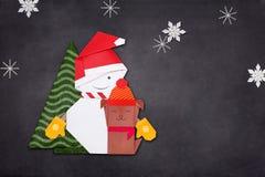 Orgami empapela el muñeco de nieve con el árbol del perro y de pino Fotos de archivo libres de regalías
