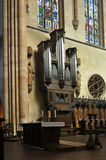 Organ - celestial music instrument. This photograph represent a detail of the organ in the Cathedral of Colmar, Alsace in France Stock Photography