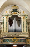 Organ and choir loft above the entrance of the church. Stock Image