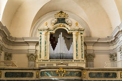 Organ and choir loft above the entrance of the church. Stock Photography