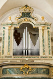 Organ and choir loft above the entrance of the church. Royalty Free Stock Images