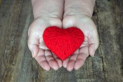 Оrgan donation, help someone. Adult woman hands giving thread r stock images