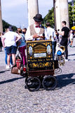 Organ Grinder at the Brandenburg Gate In Berlin Germany. The Brandenburg Gate is an 18th-century neoclassical monument in Berlin, built on the orders of Prussian stock photography