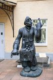 Organ Grinder-bronze sculptural composition from the series of townspeople. Author Zurab Tsereteli stock images