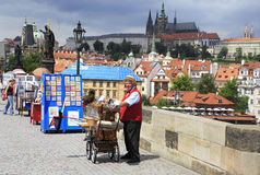 Organ grinder on the Charles Bridge Stock Images