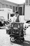 Organ grinder, man, with musical box in city royalty free stock photos