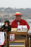 The organ grinder and a monkey. Royalty Free Stock Photo