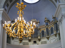 Organ in Helsinki Lutheran cathedral (St. Nicolas church) and chandelier out of focus, Finland Royalty Free Stock Images