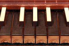 Organ Keys. Details of a bone and ebony tracker organ keyboard Stock Photo