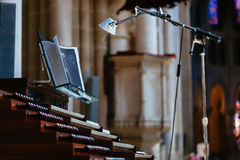 Organ with lamp in old church. Organ with a lot of keys and lamp in old church Stock Images