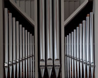 Organ Pipes. Symmetrically organized organ pipes from danish church Stock Photos
