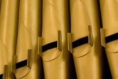 Organ Pipes. Large Gold Church Organ Pipes Royalty Free Stock Images