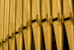 Organ Pipes. Large Gold Church Organ Pipes Royalty Free Stock Image