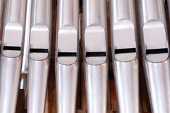 Organ pipes. Inside a church stock image