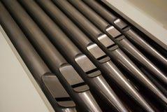 Organ pipes closup. Cathedral organ metal pipes closup Royalty Free Stock Images