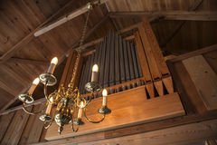 Organ pipes with luminaire Stock Photos