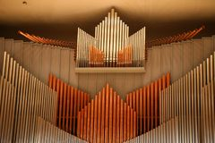 Organ pipes. On the wall in the symphonic concert hall stock photo