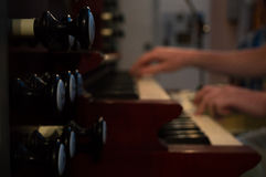 Organ playing. With knobs and manuals, selective focus royalty free stock photo