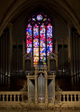 Organ and stained glass window Stock Images