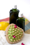 Organiс oil for body and massage. Organic oils for massage and brush massage stock photography