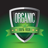 Organic 100 percent fresh on green shield Stock Images