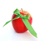 Organic apple. Red apple with green bow Royalty Free Stock Images