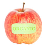 Organic Apple. One red organic apple with a green label. Isolated on white Stock Photography