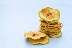 Organic apple chips. Dried fruits. Healthy sweet snack. Dehydrated and raw food. Copy space stock photo