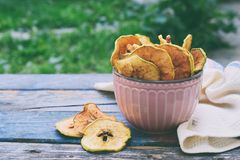 Organic apple chips. Dried fruits. Healthy sweet snack. Dehydrated and raw food. Copy space royalty free stock photography