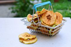 Organic apple chips. Dried fruits. Healthy sweet snack. Dehydrated and raw food. Copy space stock images
