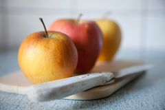 Organic apples. Close up shot of three ripe organic apples Stock Photography