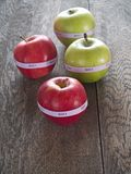 Organic apples. Organic bio apples on a rustic wooden table Royalty Free Stock Image