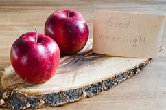 Organic apples and Good morning note on rustic wooden background. Royalty Free Stock Images